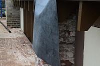 Buttress stripped of veneer brick