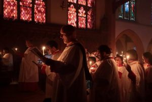 The choir re-enters the chancel